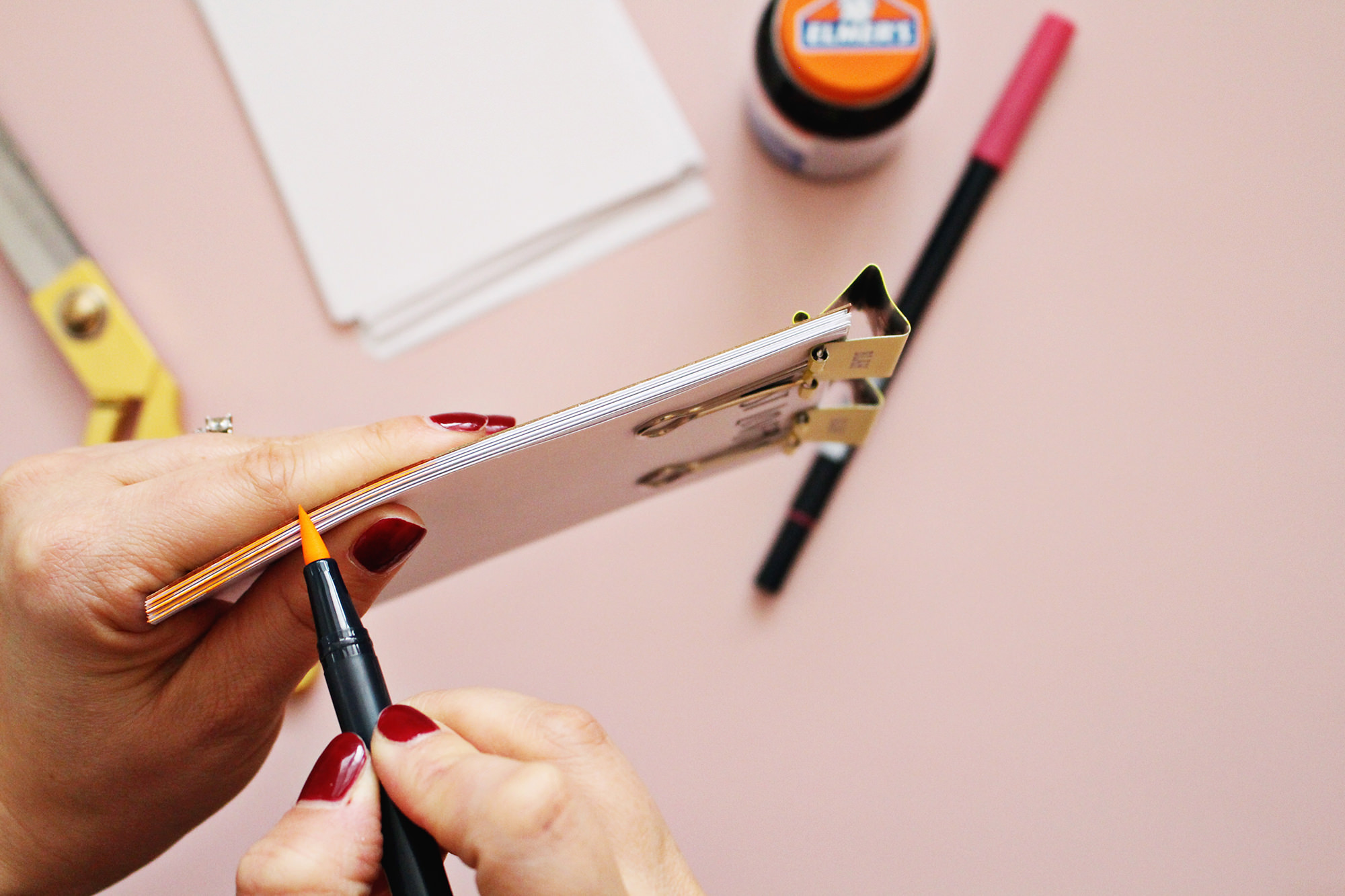 For an extra pop of color, use a marker to color the edges of the pages of your DIY notepad