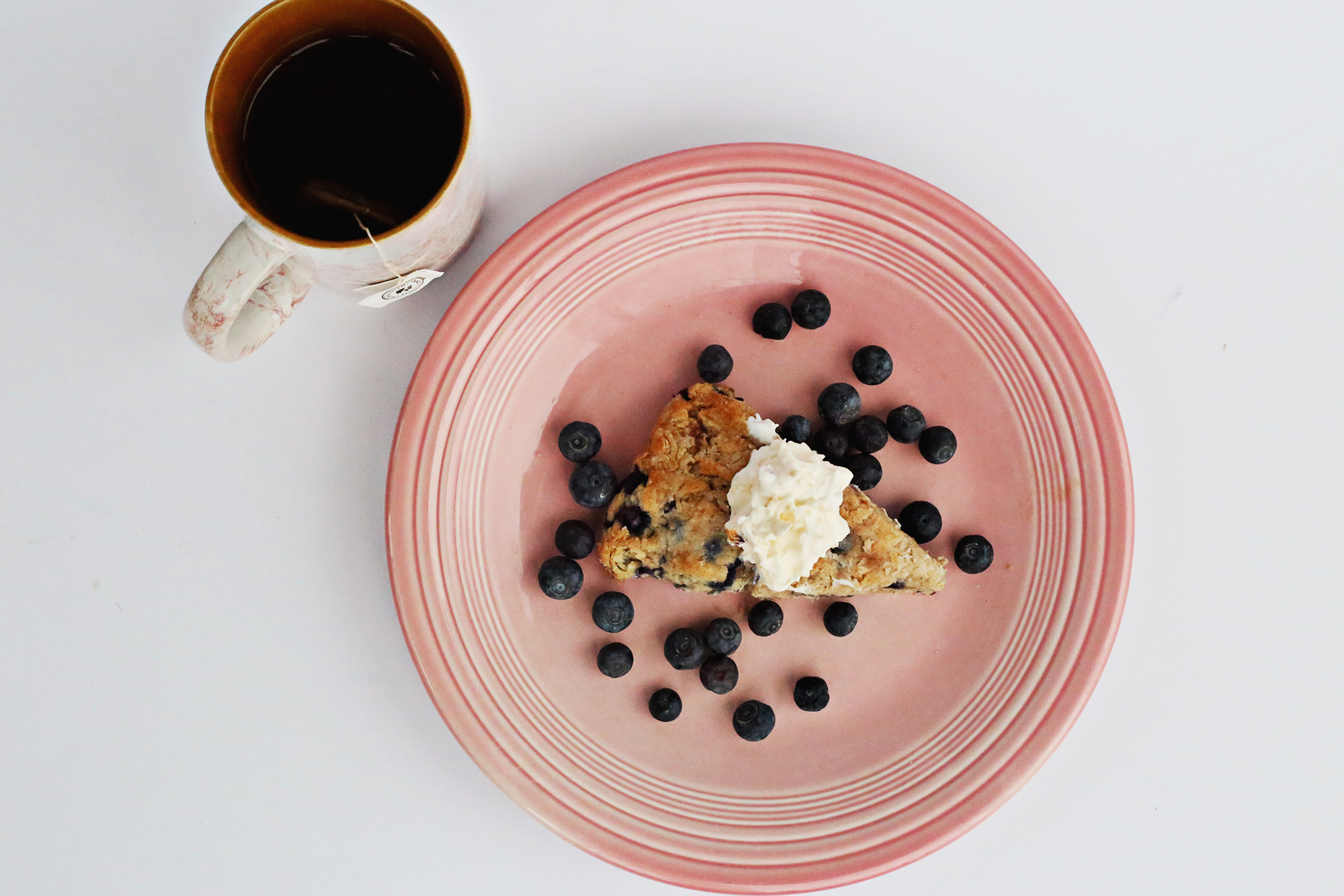 Bring back tea time, by mixing up a batch of delicious blueberry scones with clotted cream.