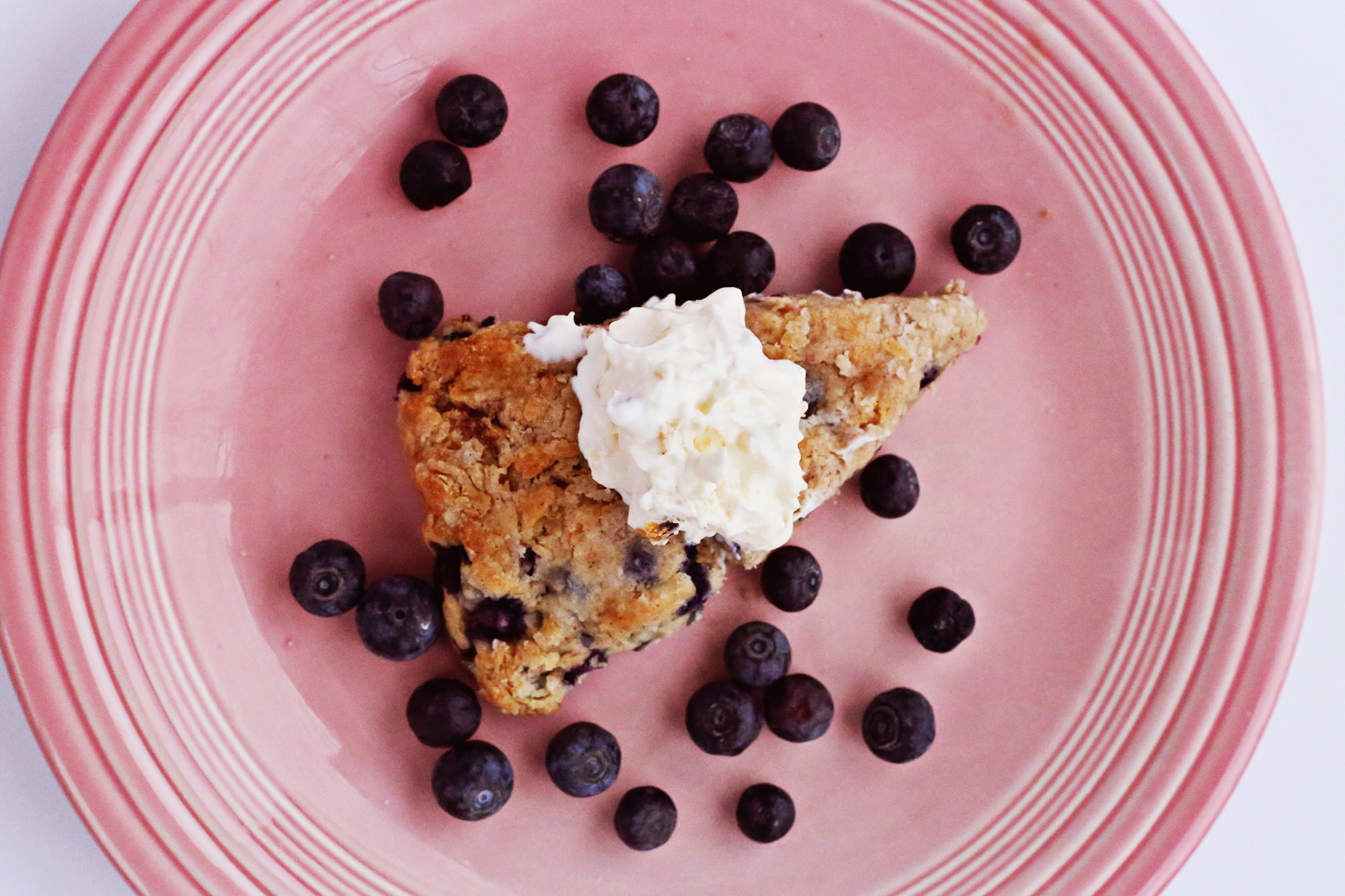 Tea time isn't the same without blueberry scones and clotted cream! Visit Lily & Val Living for the recipe!
