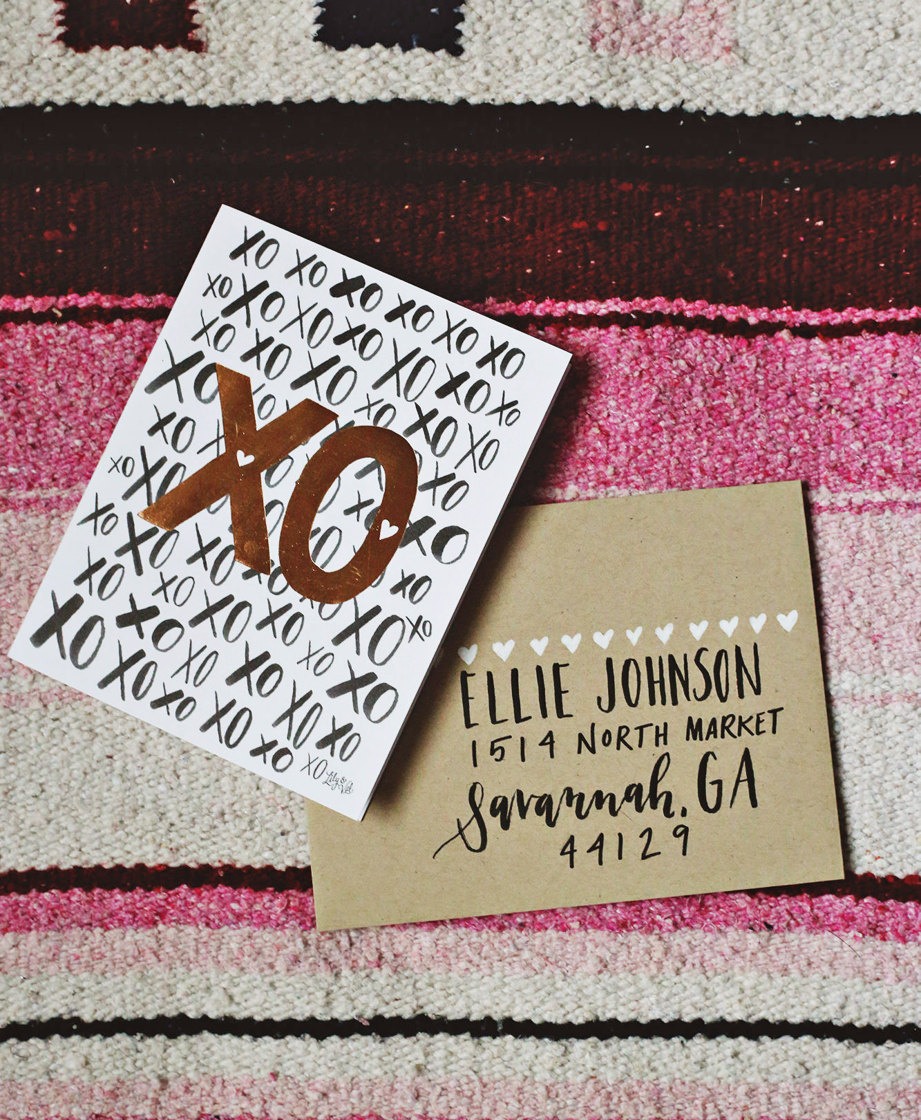 Lily & Val rose gold foil XO card inspired this simple black and white envelope address on a kraft paper envelope
