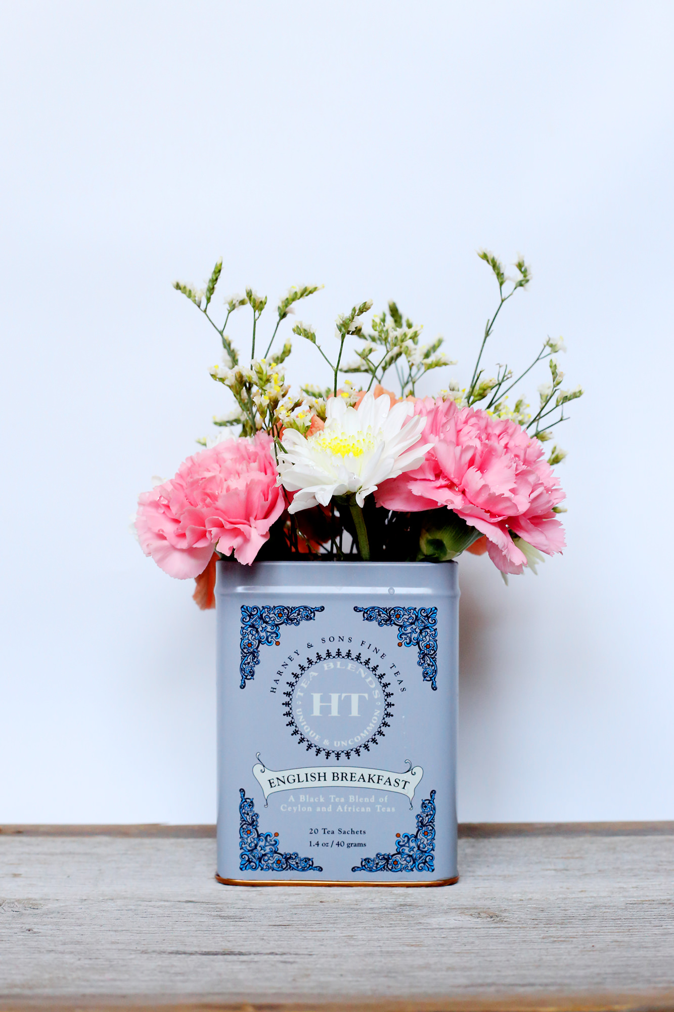 Harney & Sons Tea tins make for beautiful flower vases! Fun colored tins make all the blooms pop!