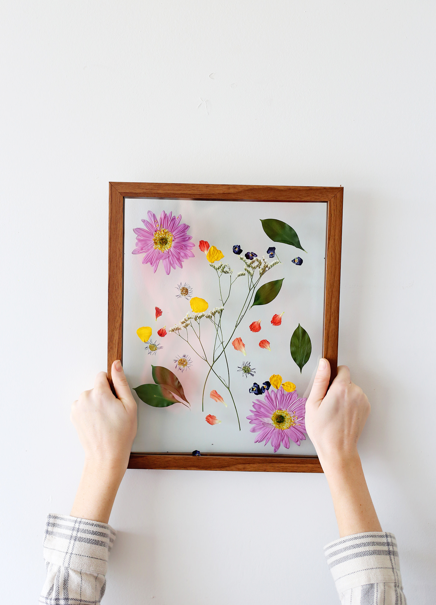 You can arrange your pressed flowers into a pattern or design, but we like keep something natural as organic as possible. Visit Lily & Val Living for more details!