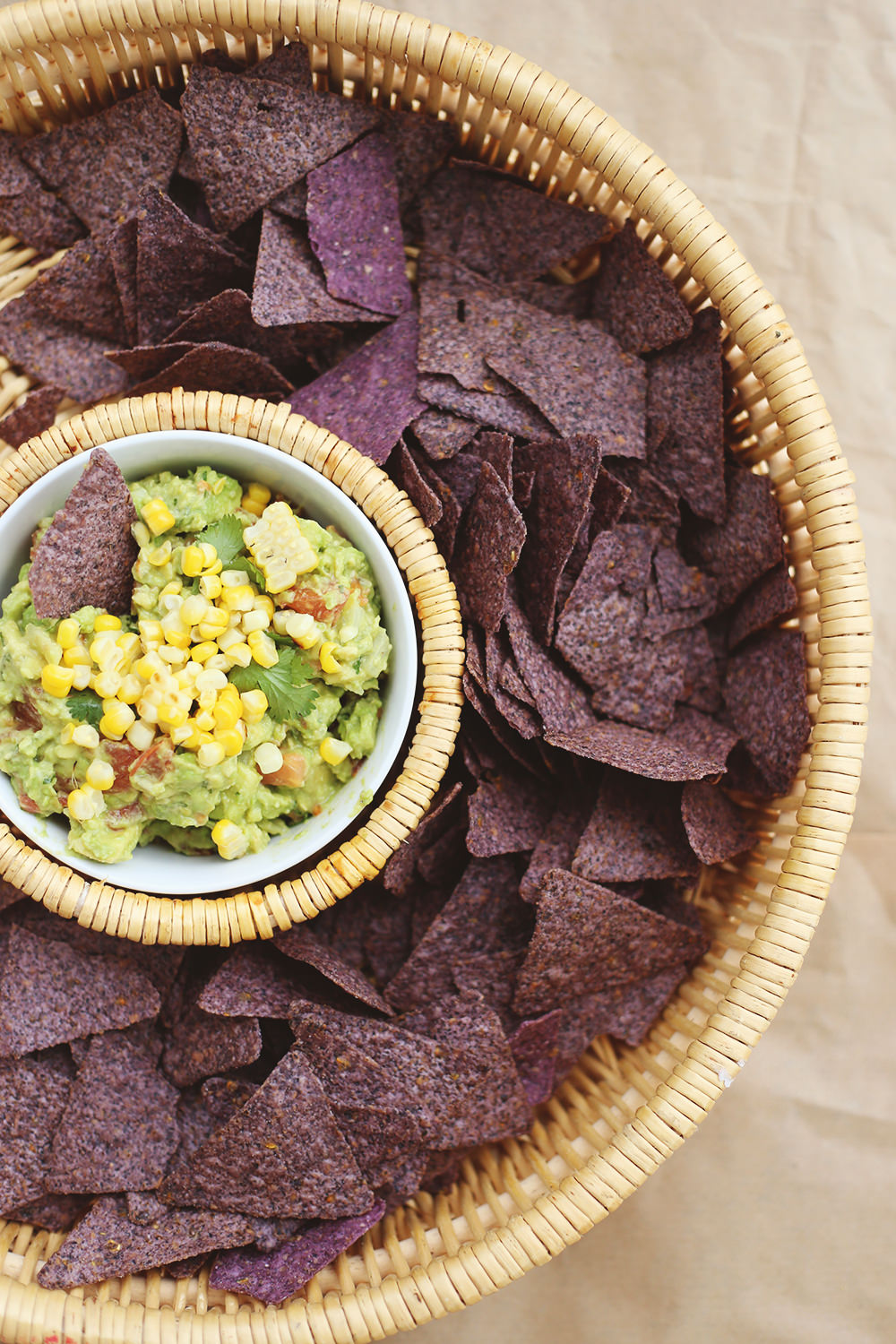 Grill one ear of corn and cut off the kernels to add to your guacamole recipe. To see other ways of dressing up your dip, go on the blog! // Lily & Val Living!
