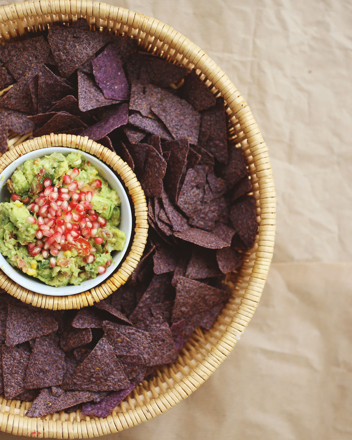 Add pomegranate seeds to your guacamole recipe. To see other ways of dressing up your dip, go on the blog! // Lily & Val Living!