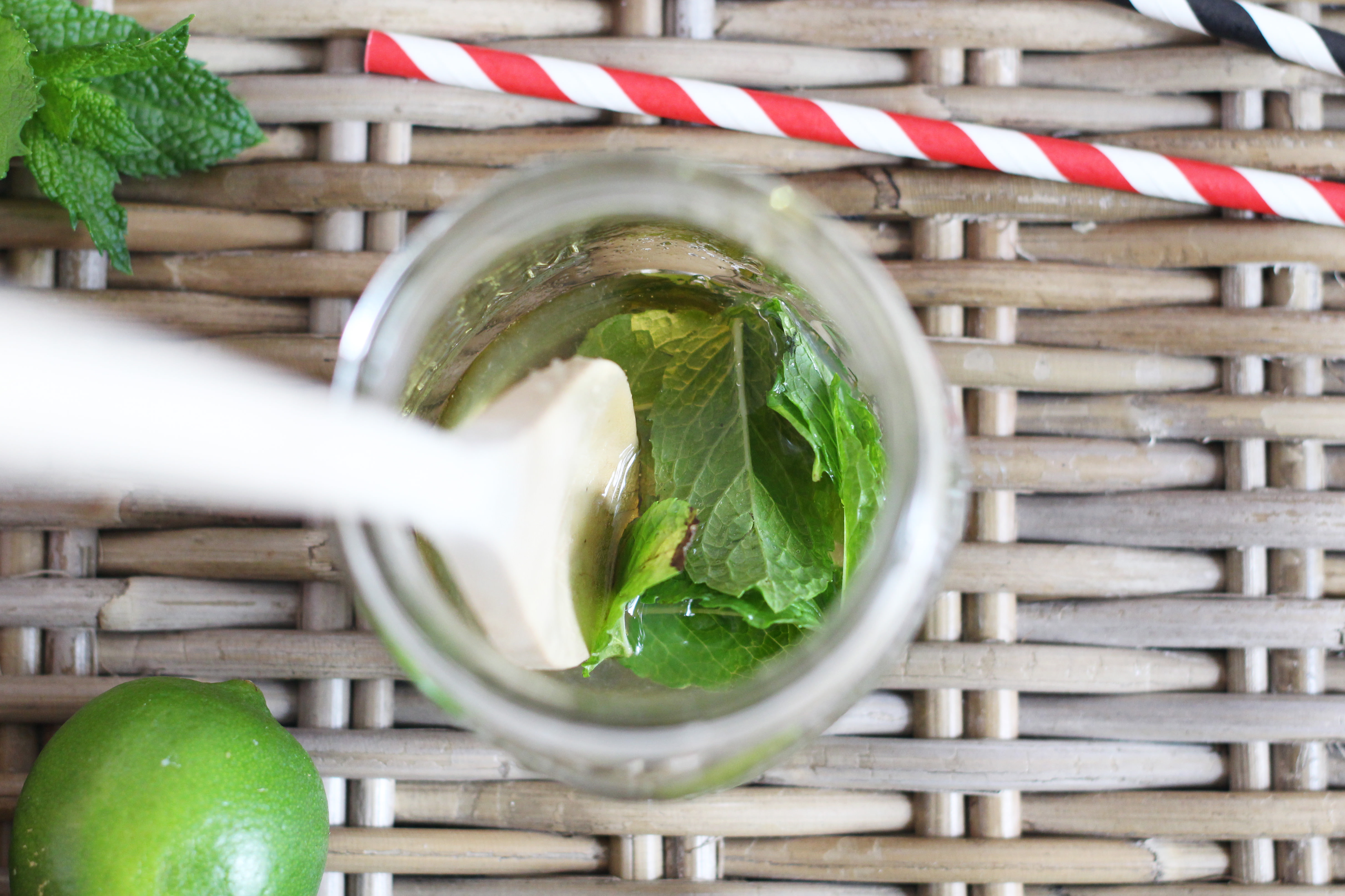 Muddle fresh mint, lime juice, and honey for the base of our Coconut Lime La Croix Mocktail
