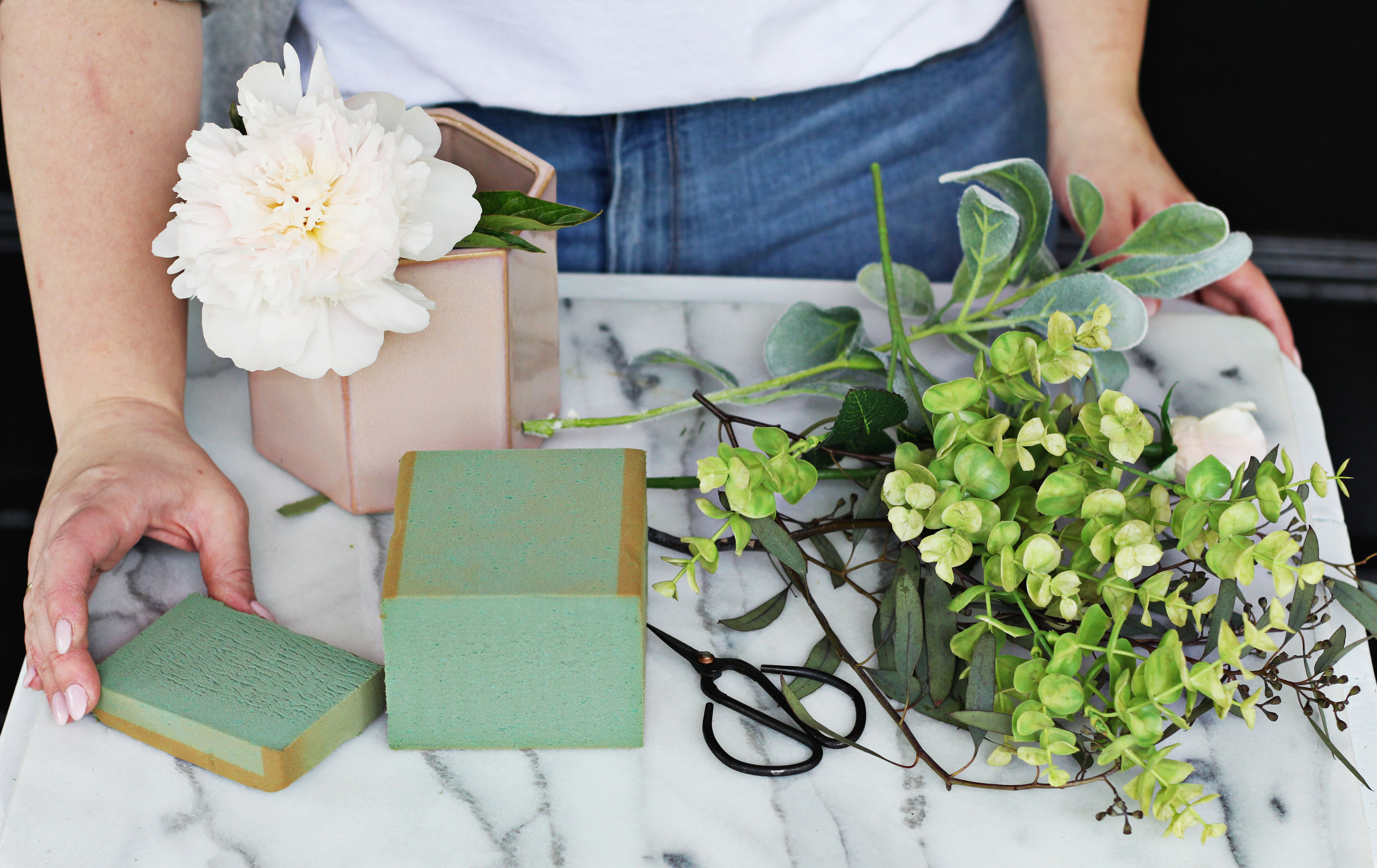 Choose a real statement flower, like a peony, and add faux greenery around it. No one will ever know!