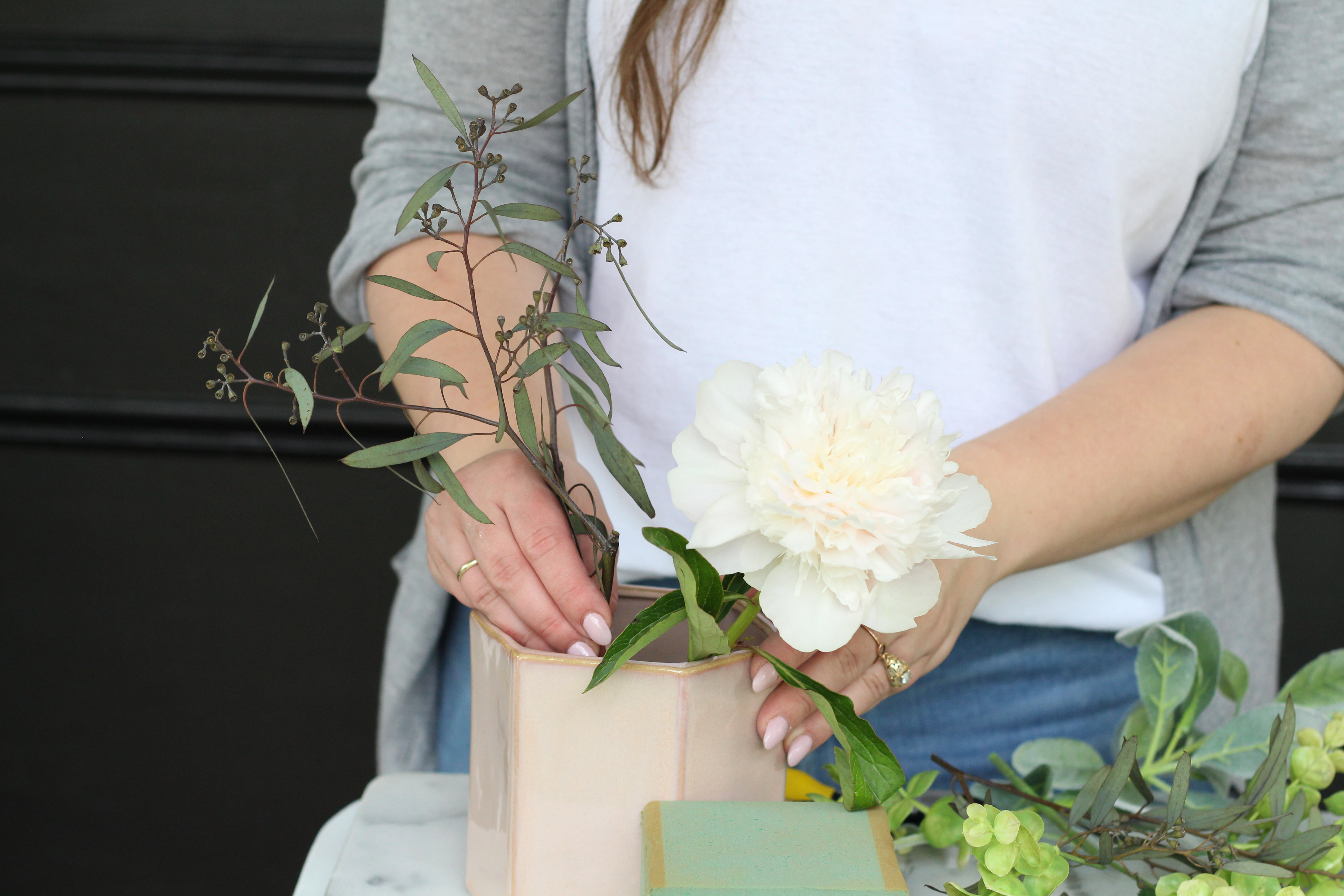 Step-by-step instructions for floral arrangements using both real and faux flowers