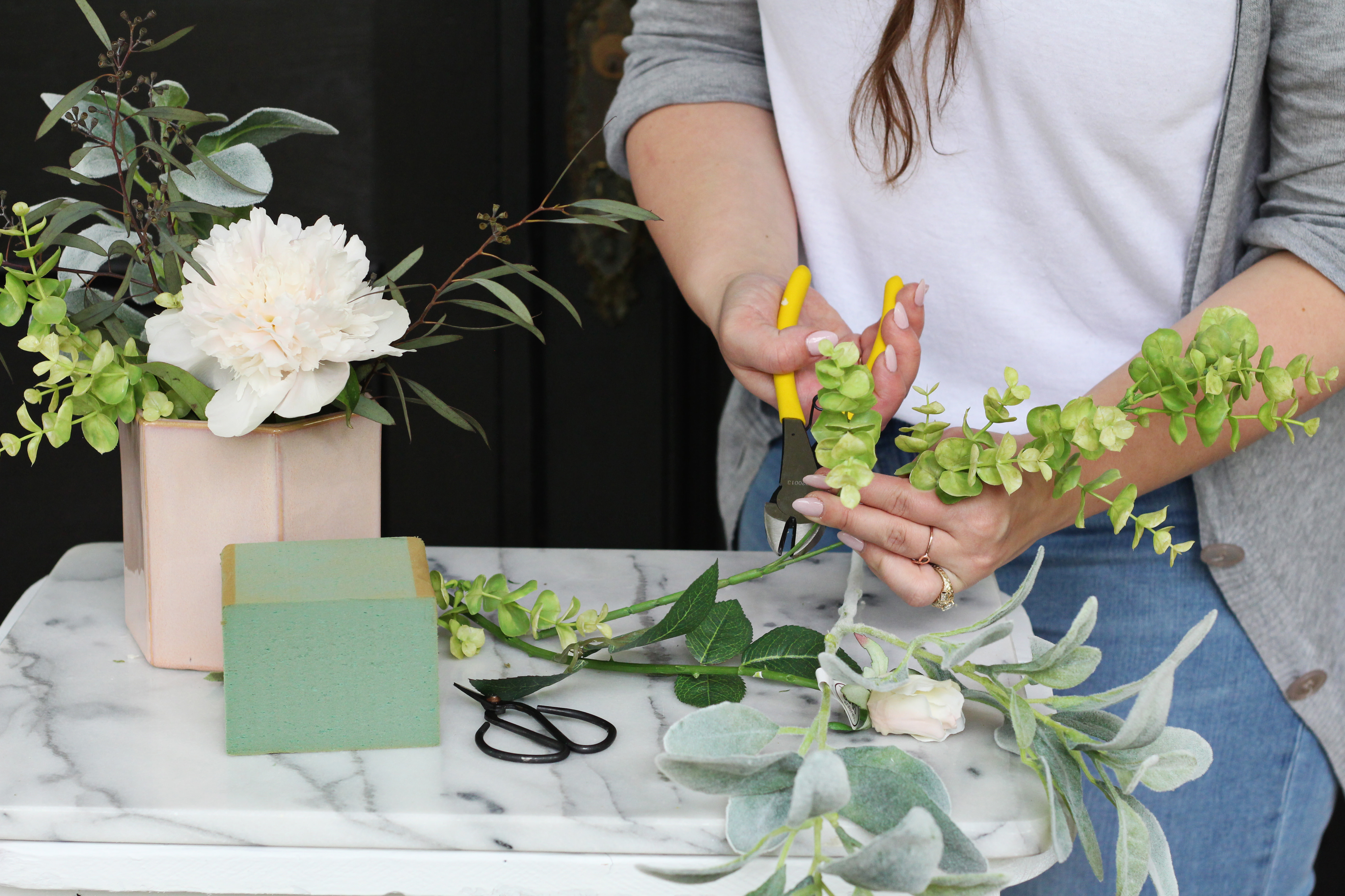 Add faux greenery to your floral designs to save money - you can use them again and again in your arranging