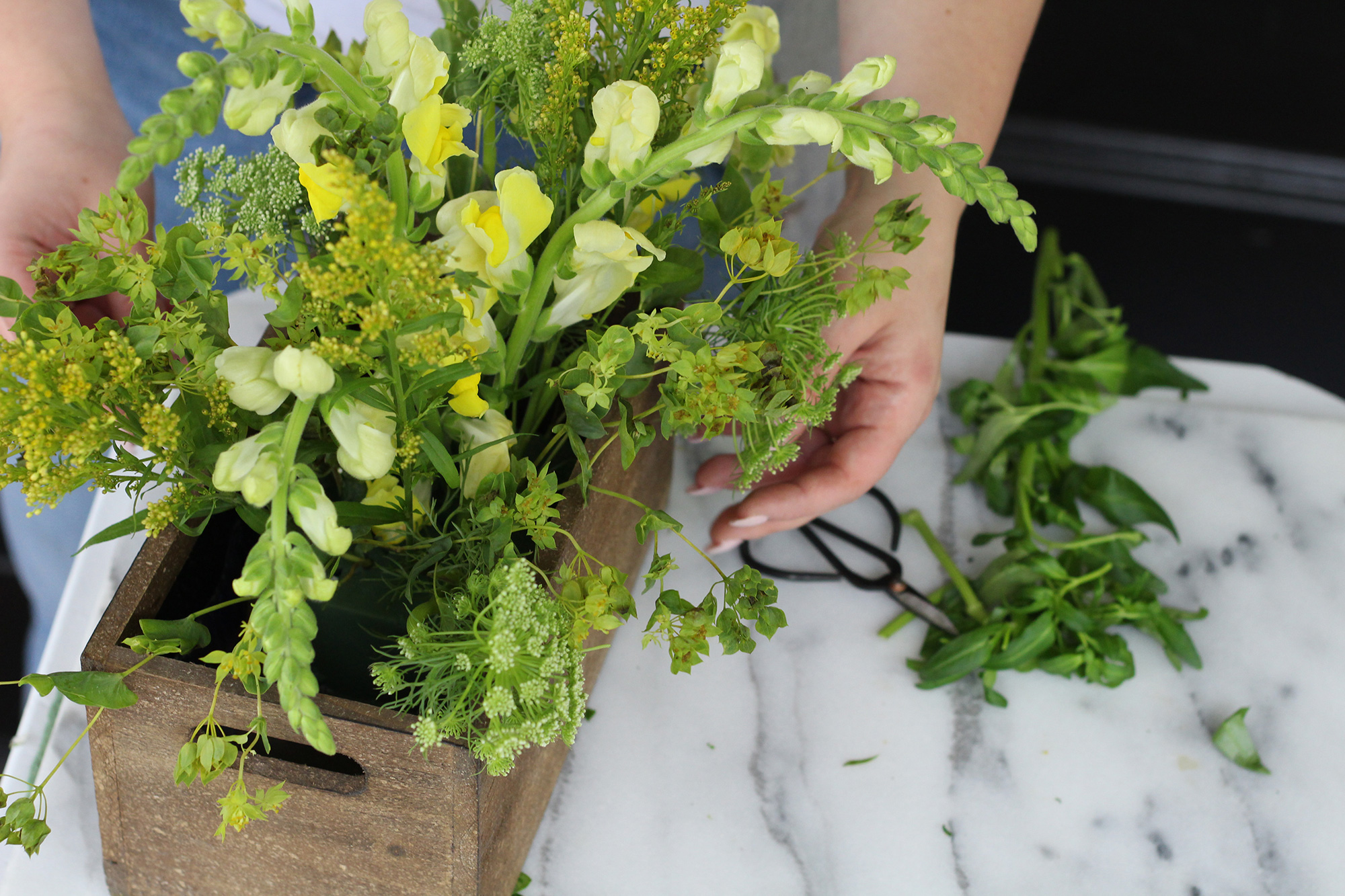 Create a beautiful end of summer monochromatic floral arrangement using both real and faux flowers