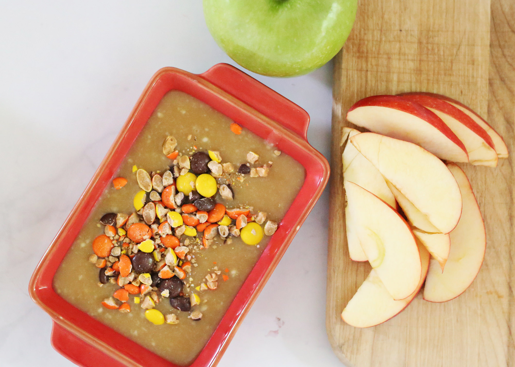 Candy toppings for a delicious caramel apple dip on Lily & Val Living!