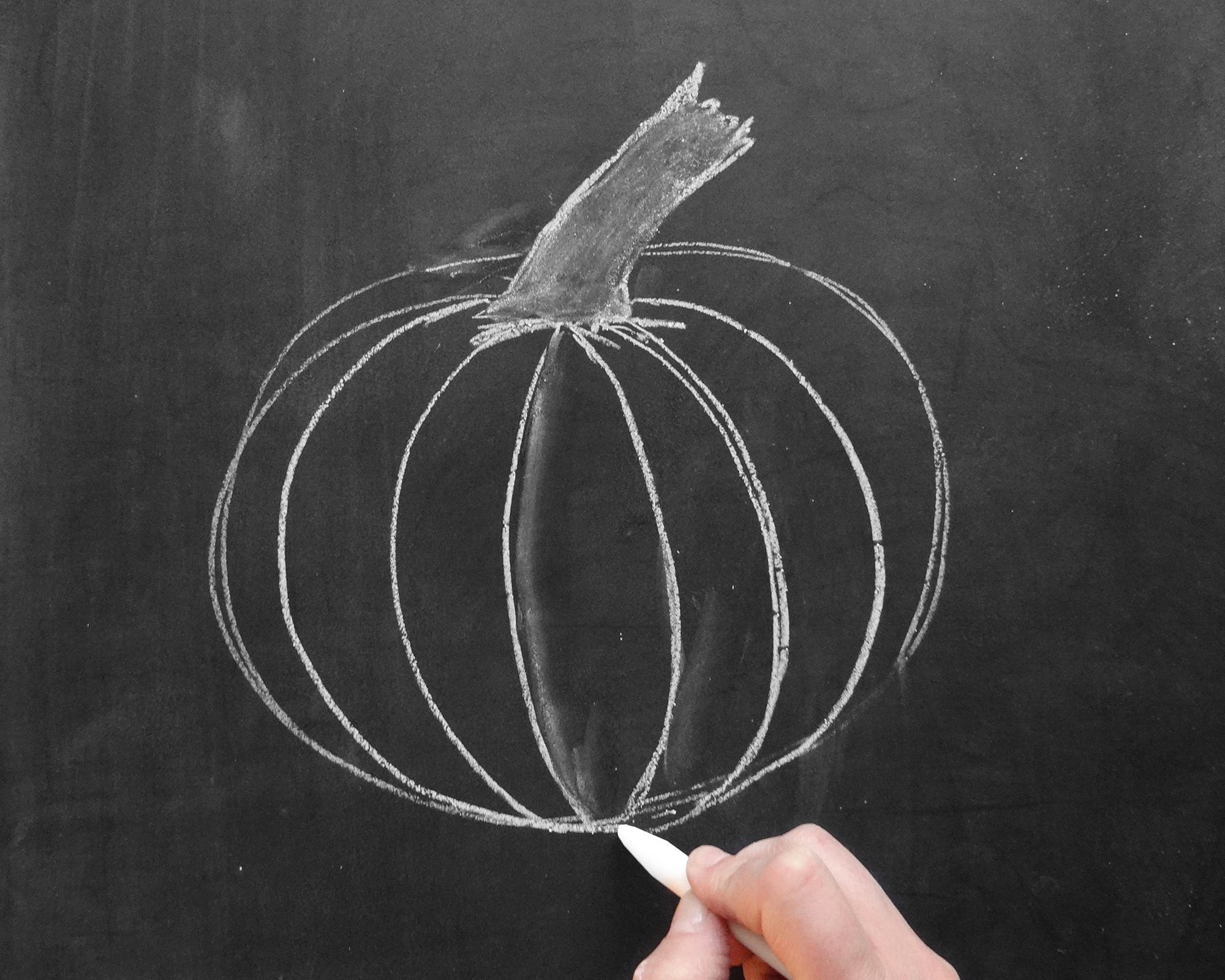 Valerie McKeehan breaks down the steps for how to draw a chalk art pumpkin.