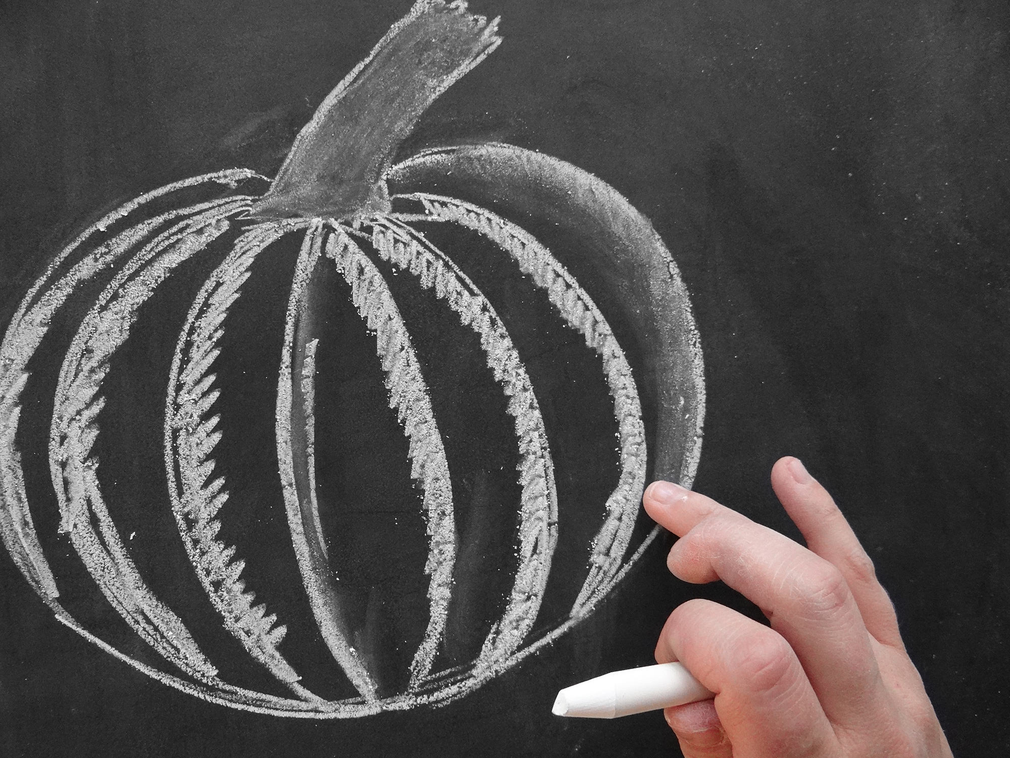 Valerie McKeehan breaks down the steps for how to draw a chalk art pumpkin on the Lily & Val Blog
