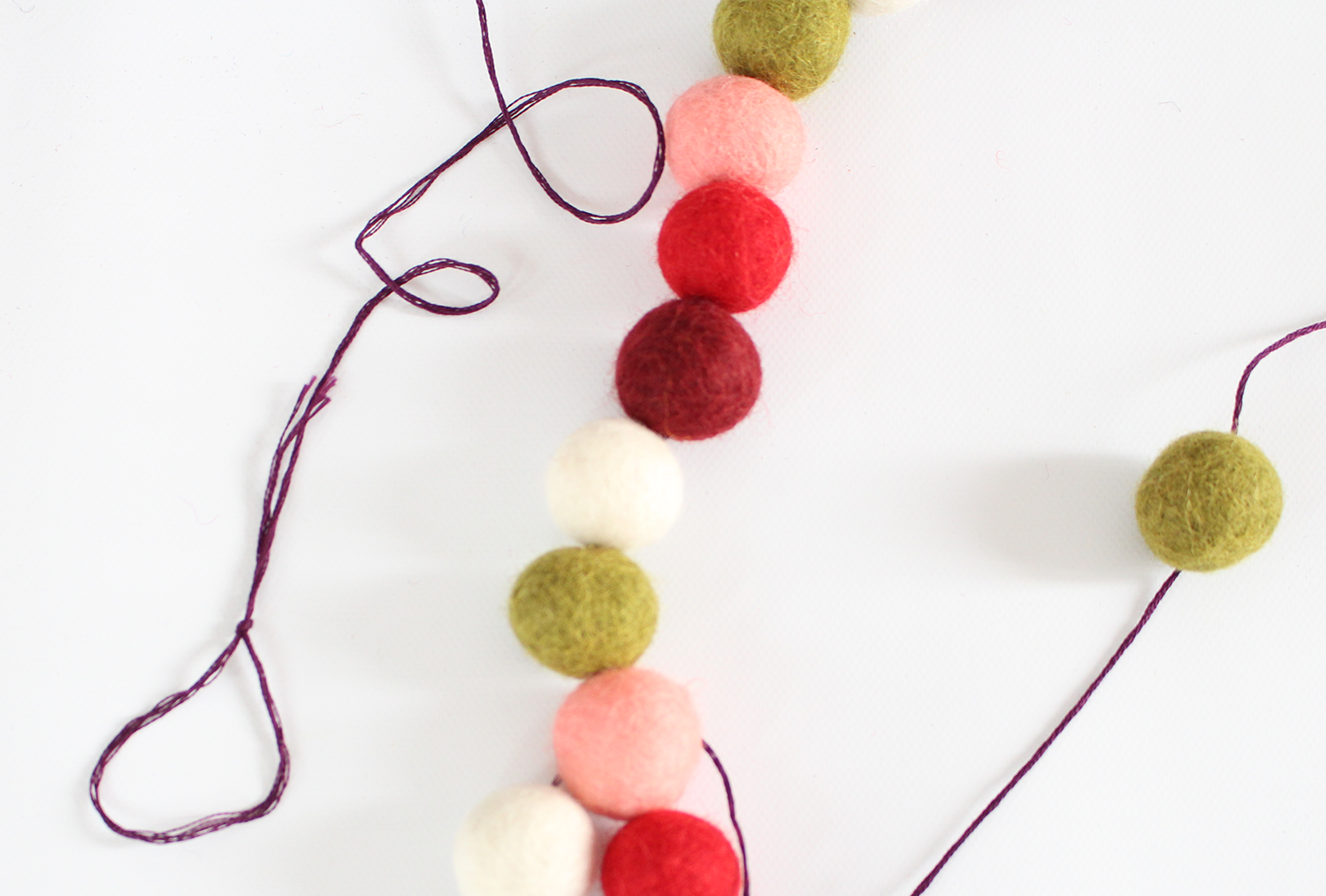 DIY felt ball garlands are easy to make for your holiday mantel decorating
