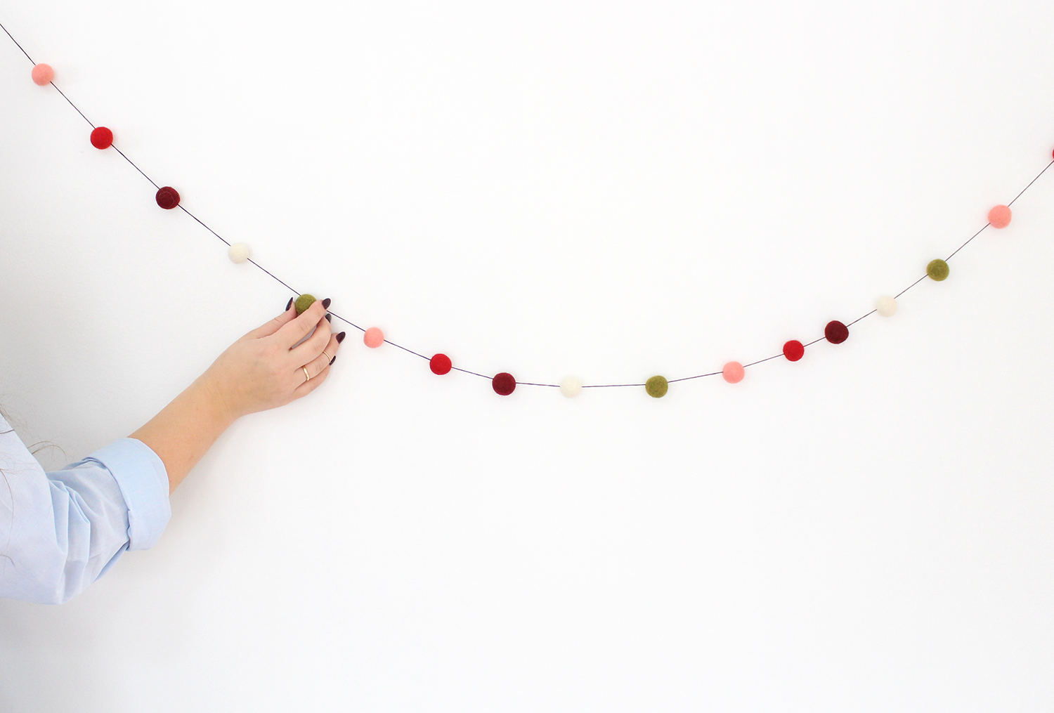 DIY felt ball garlands will make a big impact on your holiday decor this year