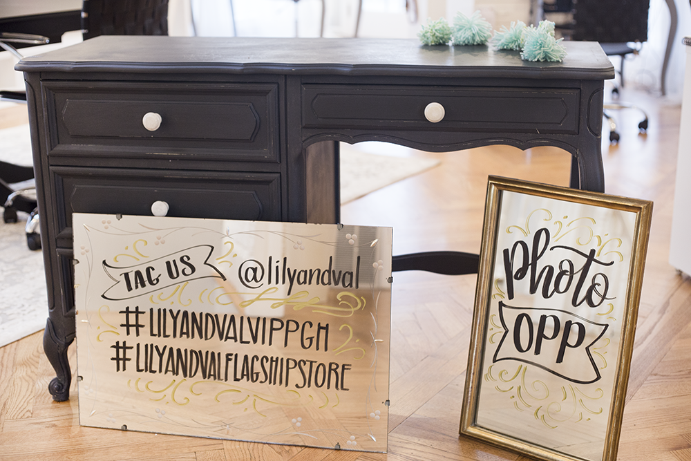 Chalk Ink Markers being used on vintage glass mirrors for a Lily & Val VIP Happy Hour Party