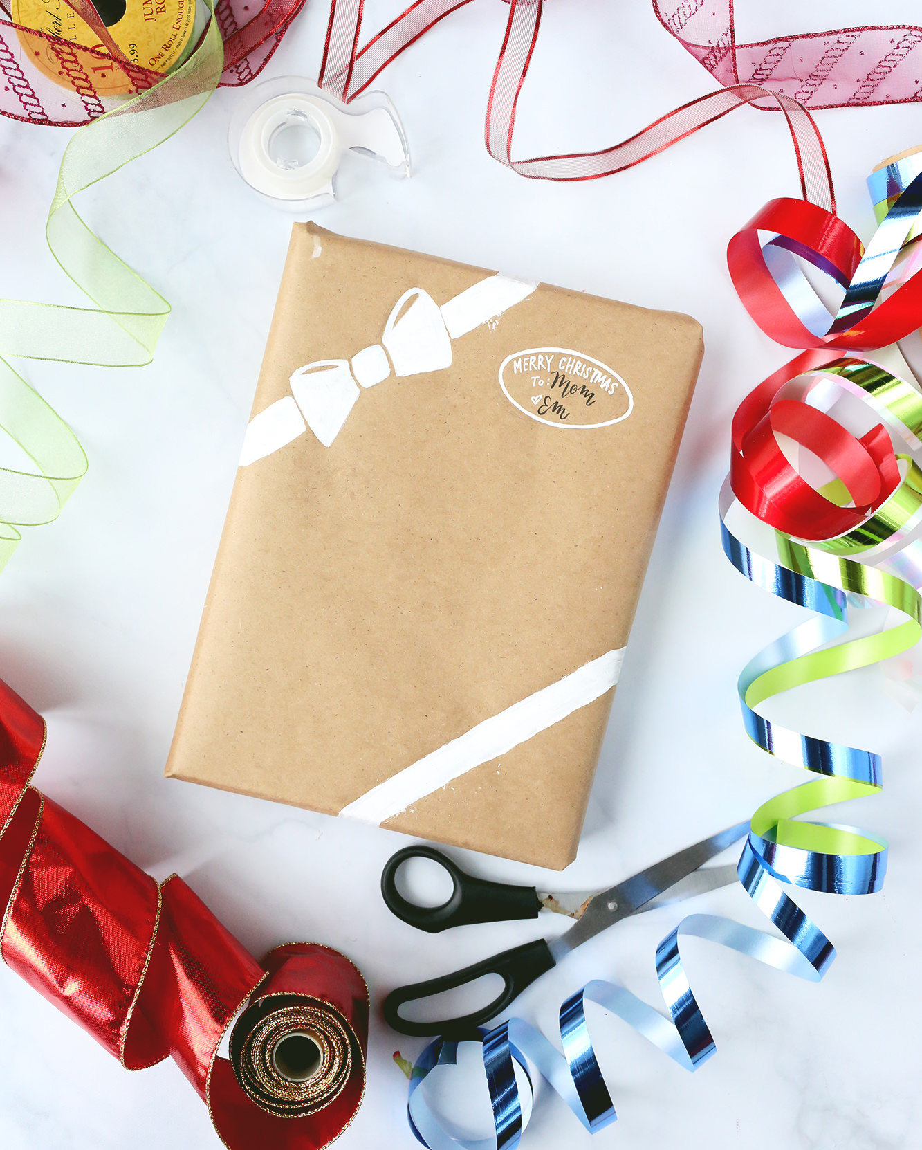 Paint a ribbon and bow on your Christmas gifts! More ideas on Lily & Val Living
