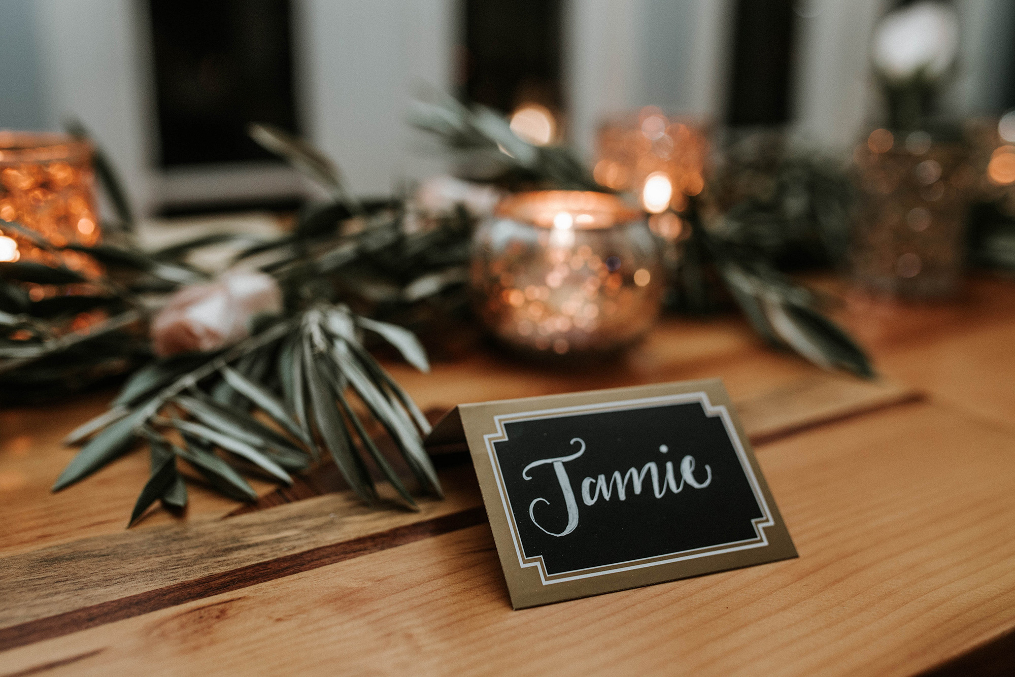 Hand-lettered place cards, Mercury glass and fresh olive branches at the Lily & Val Christmas Party held at PointBreezeway