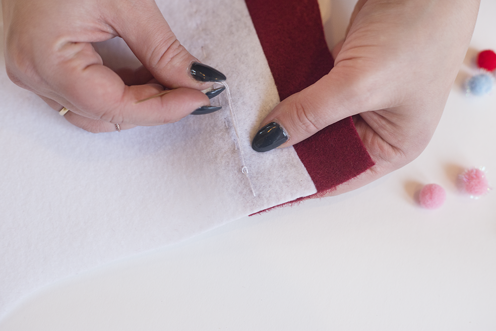 Need an easy holiday DIY? Try our hand-stitched felt stocking! It's cute, inexpensive, and only takes about an hour. Click through to read the steps and add some festive adorableness to your mantle!