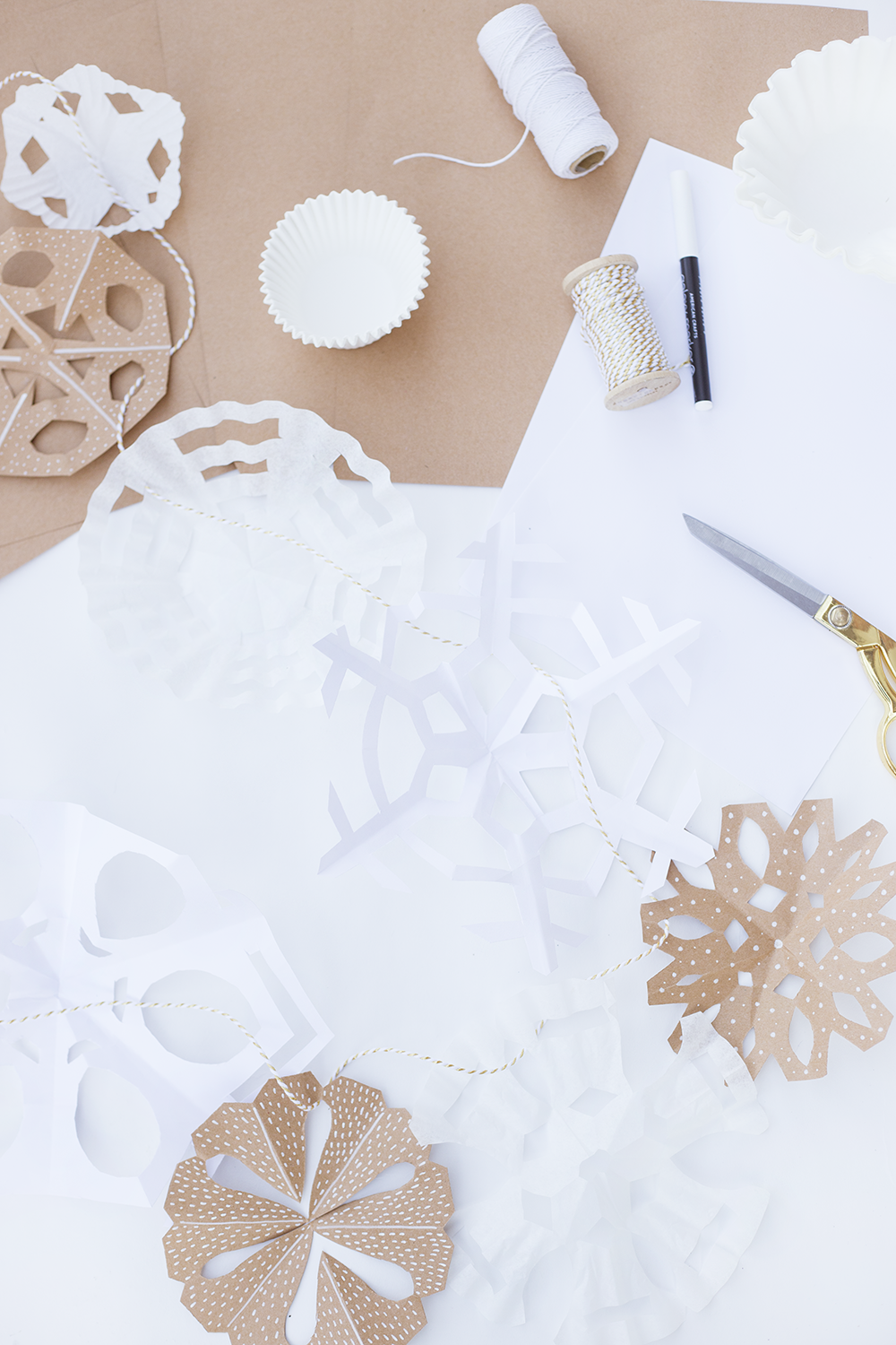 Make these modern paper snowflakes for your home this winter! Using different textures is a must for creating visual interest. Click through to read our easy DIY!