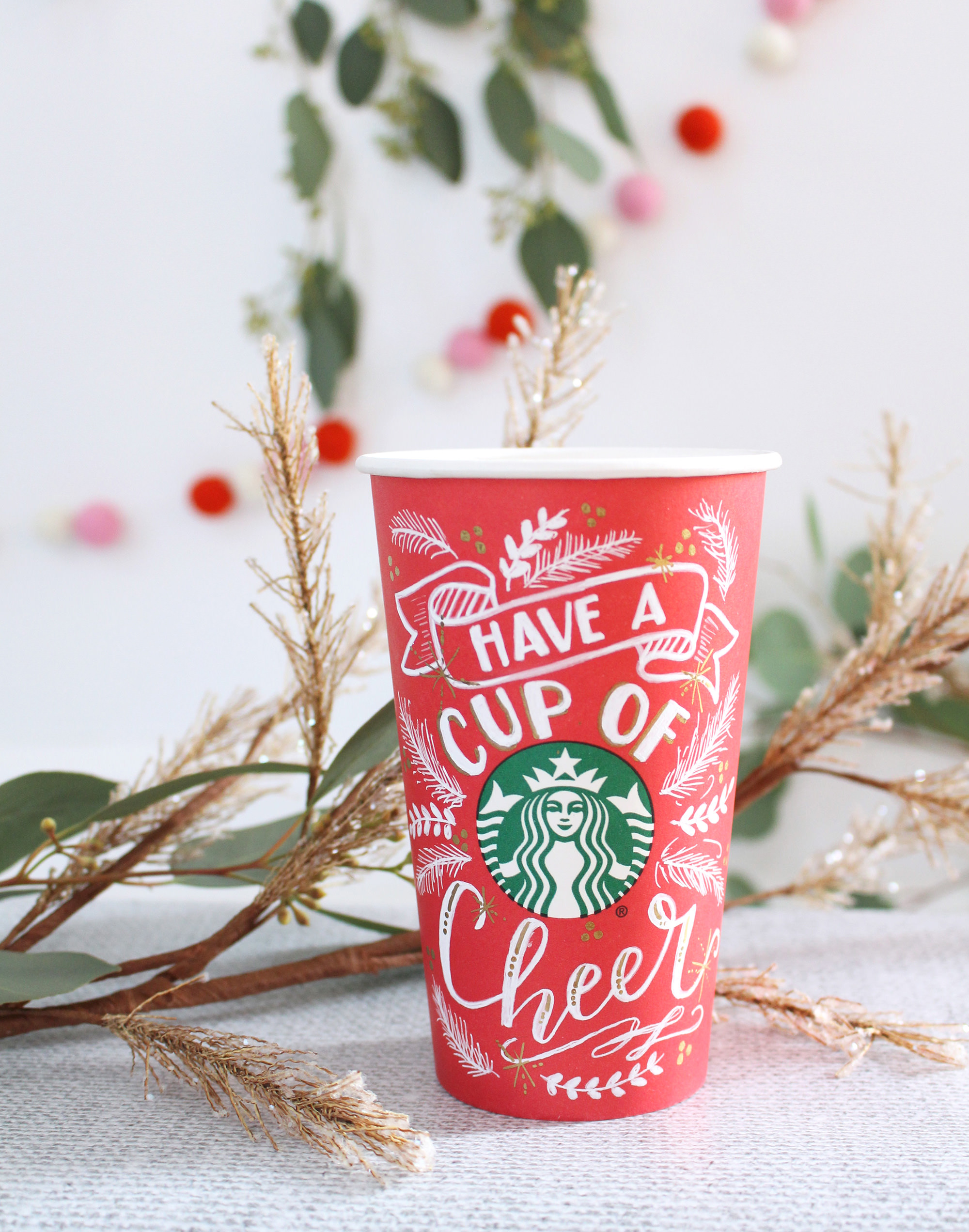 Starbucks is bringing back blank red cups on December 17th for you to add your own holiday flair! This cup was designed by Valerie McKeehan of Lily & Val.