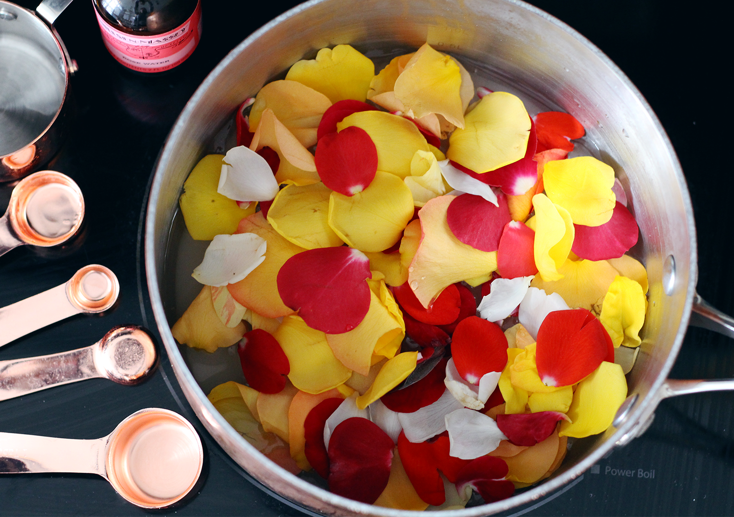 One way to use edible rose petals is by making a homemade rose simple syrup