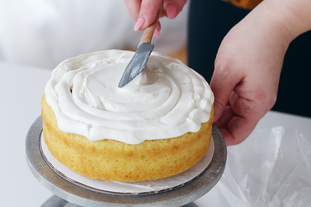 Steps for icing a cake like a pro on the Lily & Val Blog