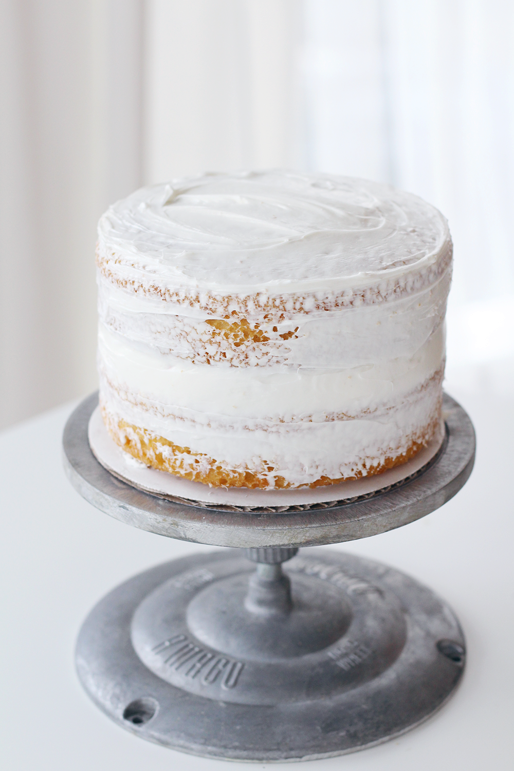 How to ice a two-tiered cake like a pro on the Lily & Val Blog