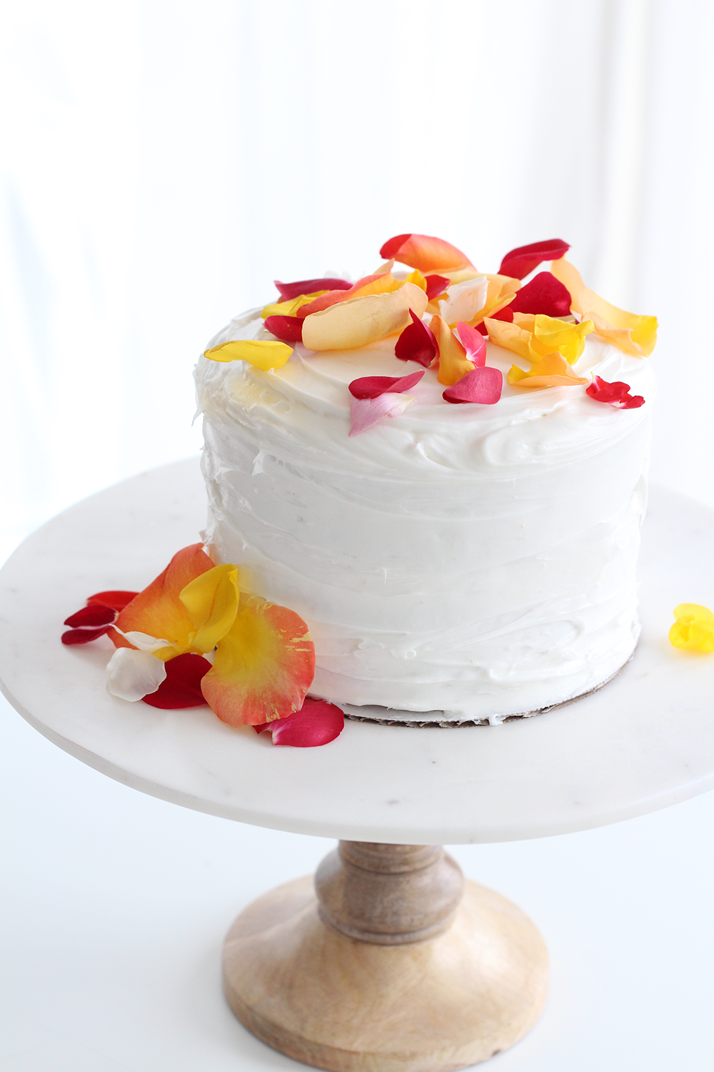 Edible rose petals make a gorgeous cake topper. Such a simple way to make a plain cake look fancy and special