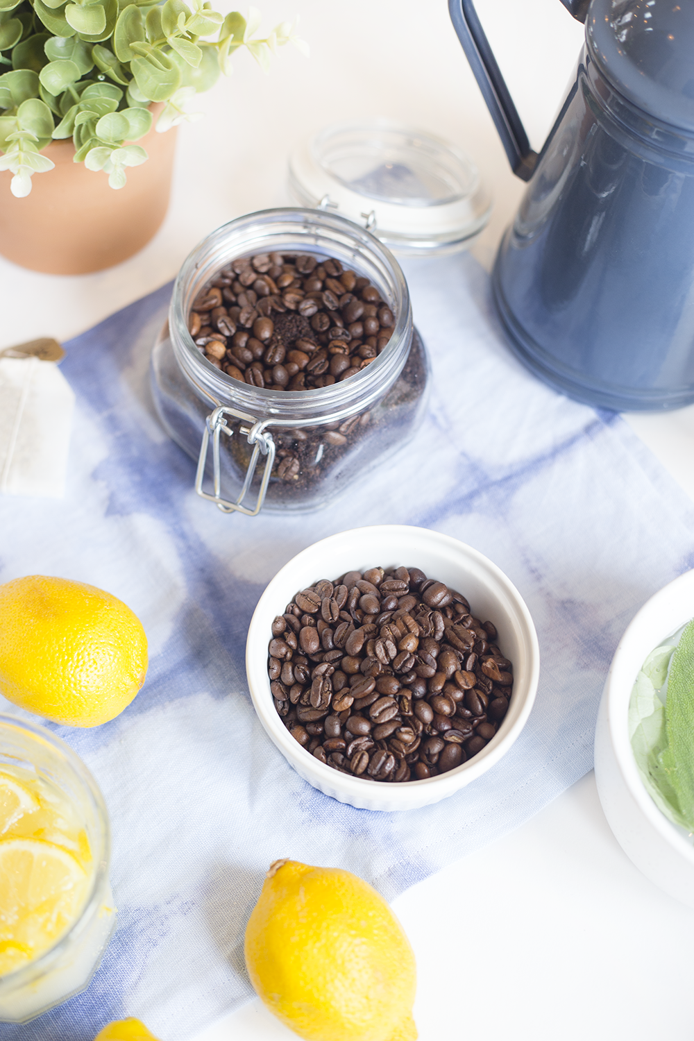 Need to recharge? Try these four at-home spa remedies including a coffee scrub, lemon foot scrub, oatmeal and milk bath, and herb steam facial to recharge. Click through for the recipes!
