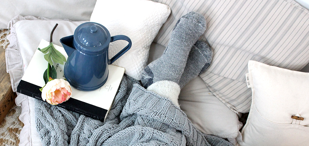 Snug blankets are amongst our Cozy Essentials this winter. Click for a list of more seasonal picks!
