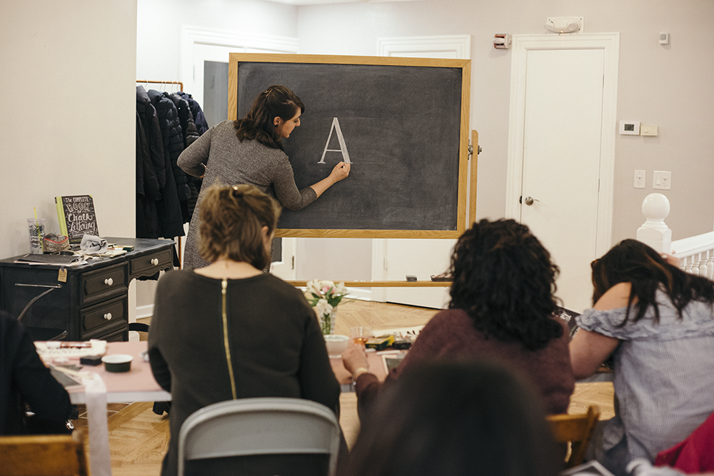 Valerie McKeehan, author of The Complete Book of Chalk Lettering, teaching a Chalk Lettering Techniques Workshop at the Lily & Val Flagship Store in Pittsburgh