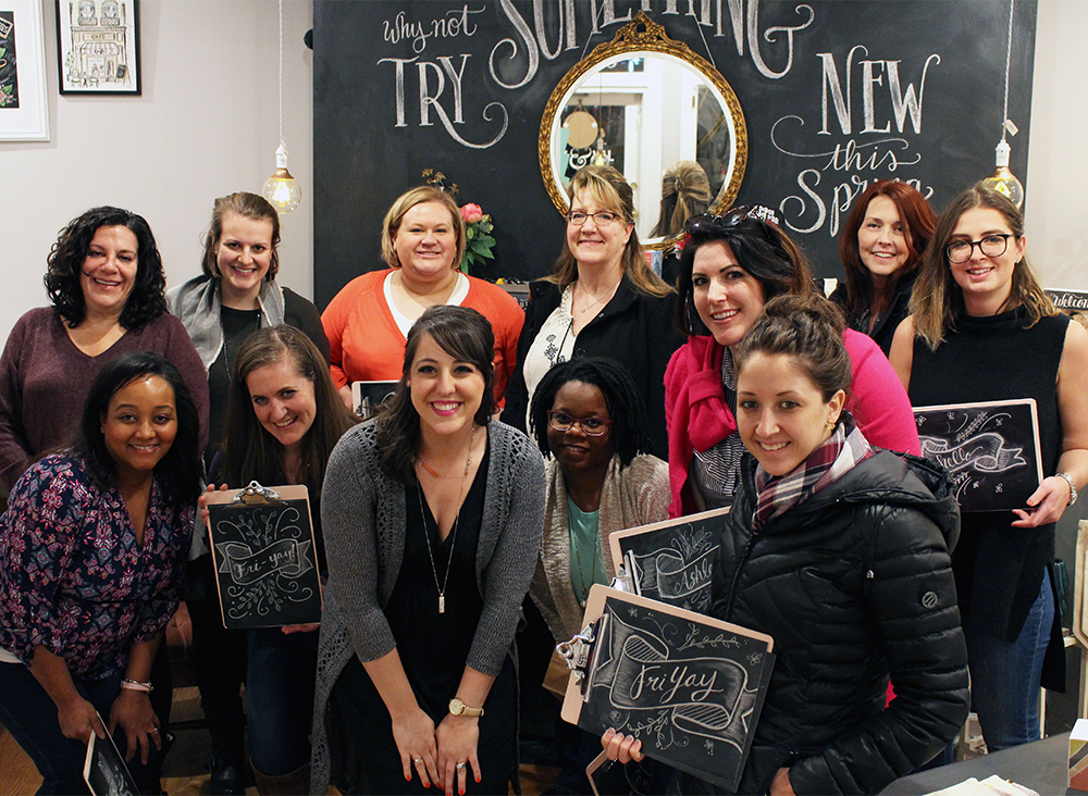 Group photo of the first ever Chalk Lettering Techniques Workshop held at the Lily & Val Flagship Store in Pittsburgh