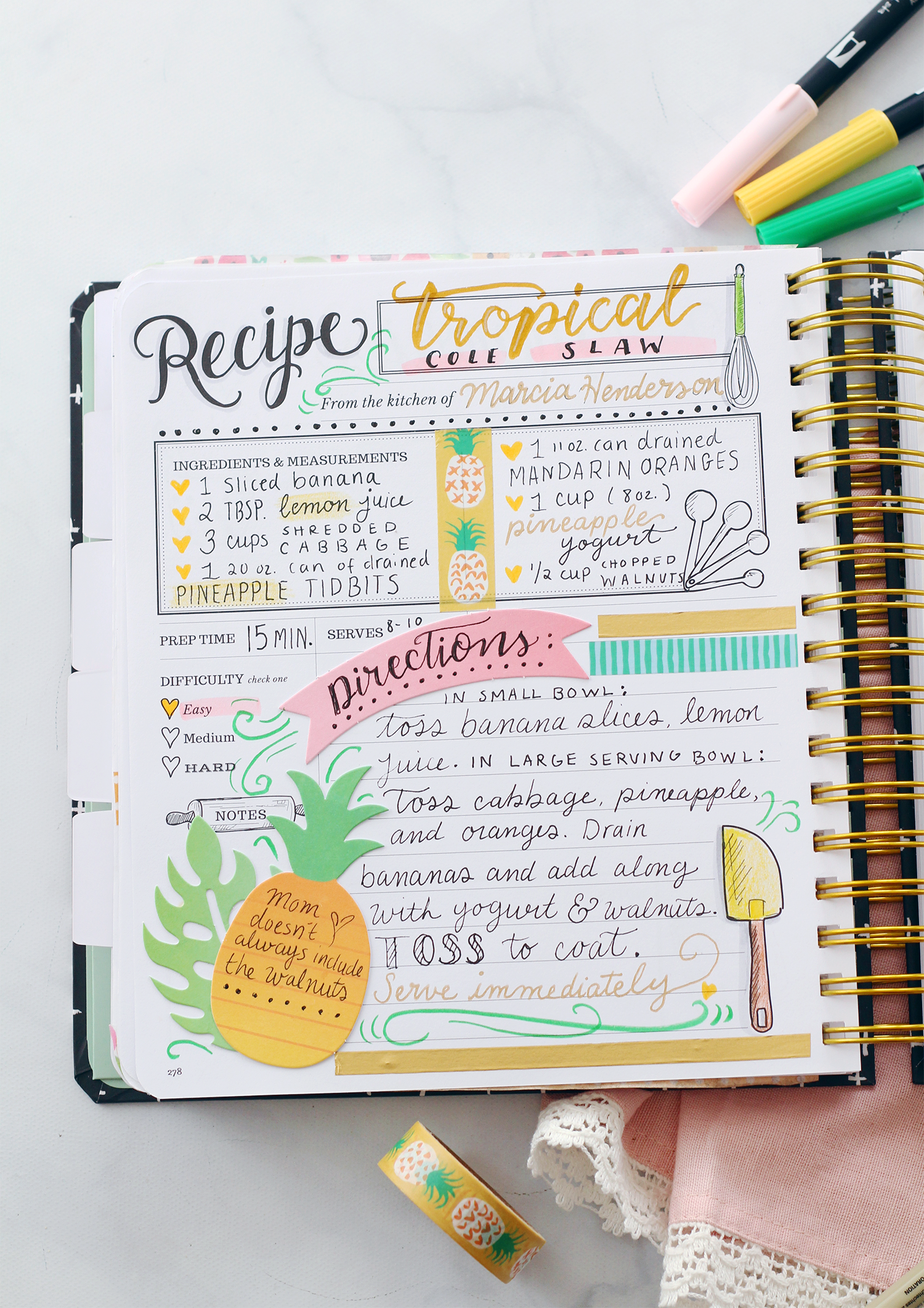 A scrapbooked recipe page in the Keepsake Kitchen Diary: A DIY recipe and memory cookbook for holding your family recipes