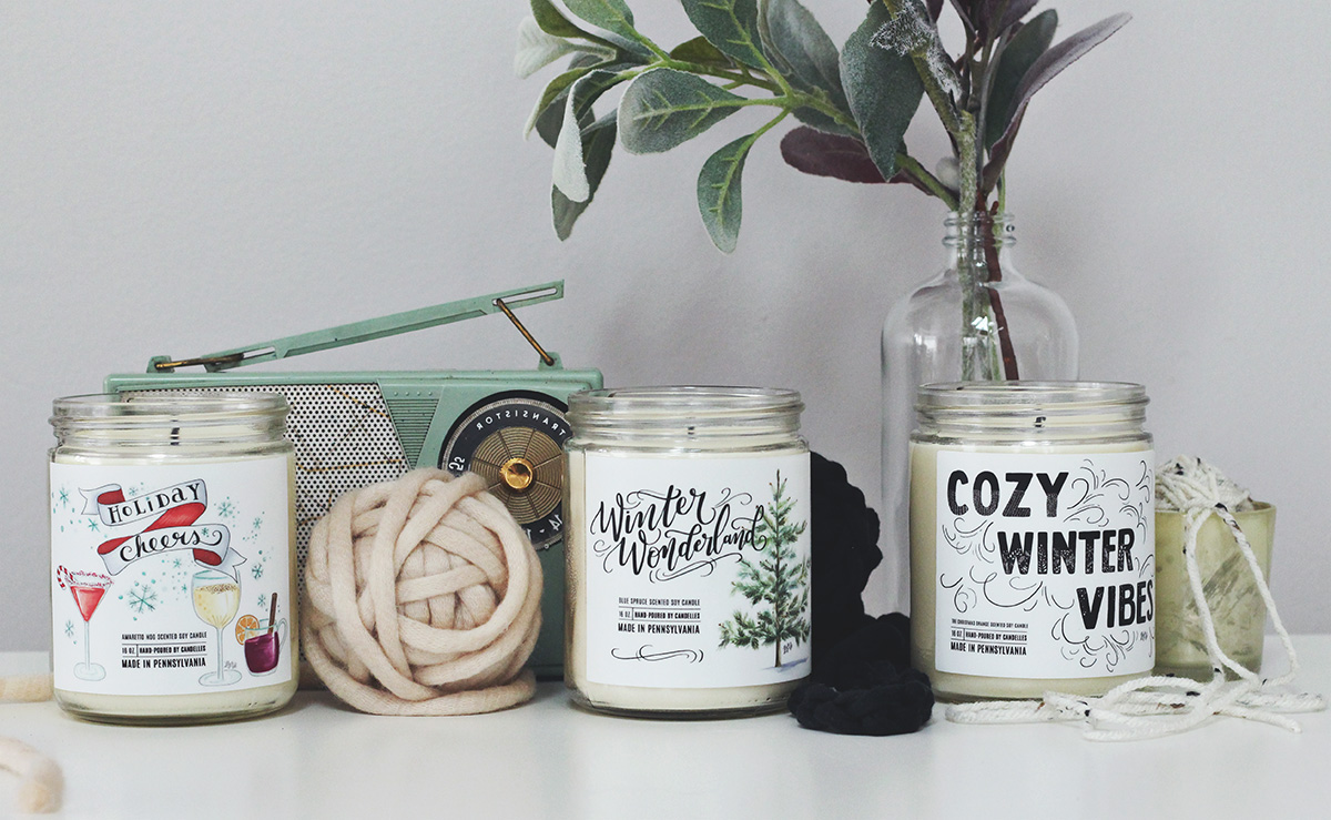 Unique holiday soy candles with labels hand-drawn by Lily & Val and hand-poured by Candelles