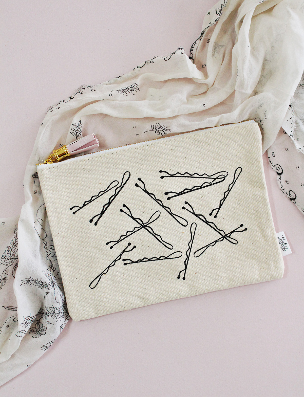 Never lose those bobby pins again with this adorable canvas zippered pouch by Lily & Val