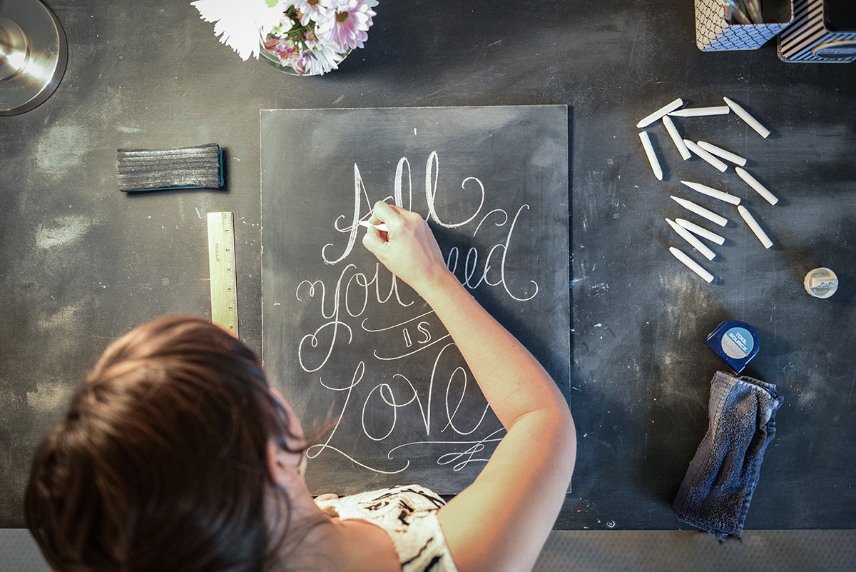 Valerie McKeehan, author of The Complete Book of Chalk Lettering, drawing in her studio