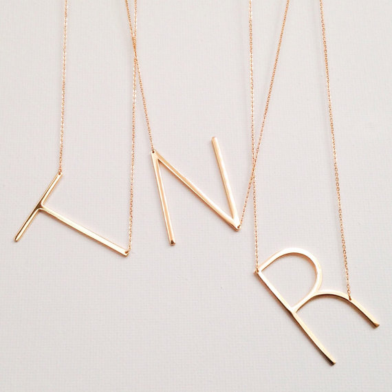 Beautiful dainty letter necklaces.