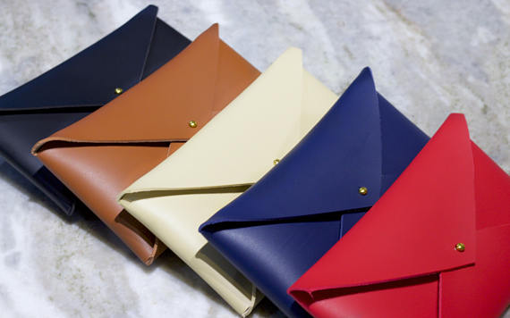 These gorgeous envelope clutches are handmade and super affordable