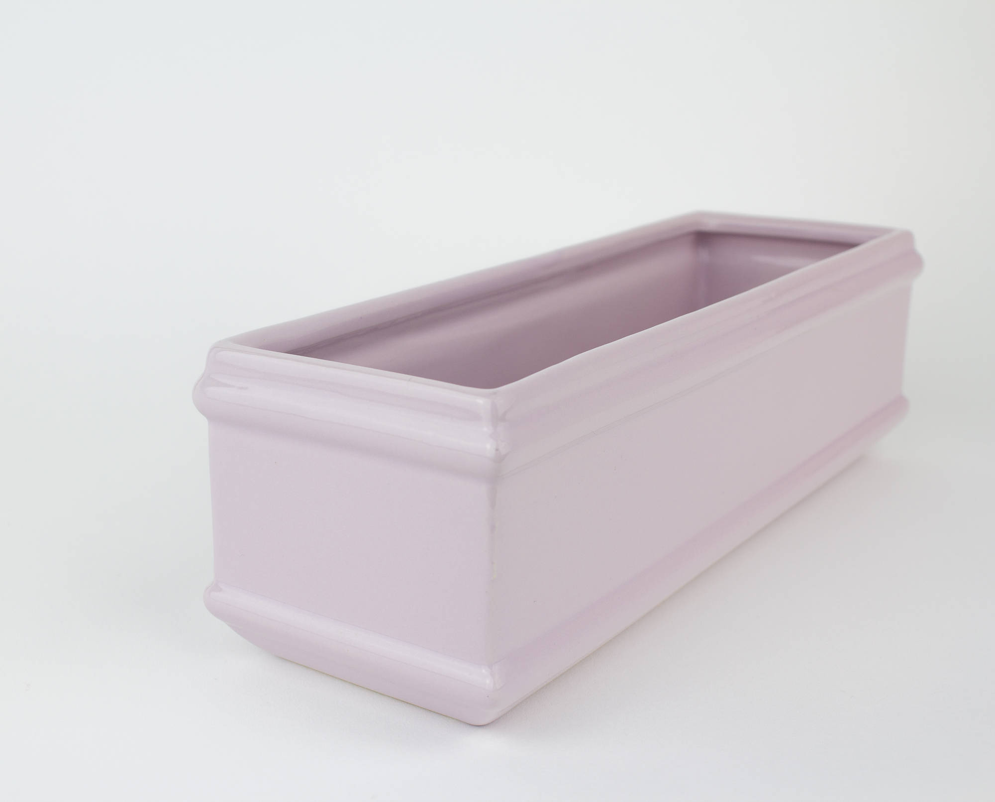 This beautiful lilac ceramic planter is just the perfect size for a spring window sill