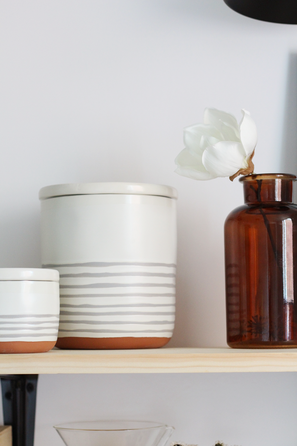 Take kitchen items out of their package and put them into attractive canisters and vessels. - How to decorate your open kitchen shelving.