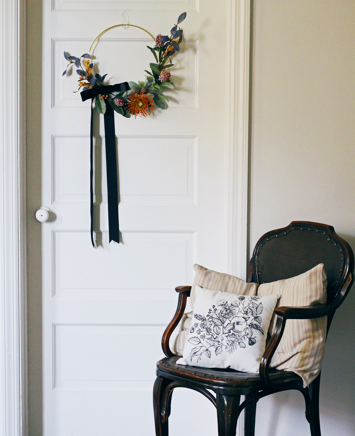 Display a wreath on an interior door