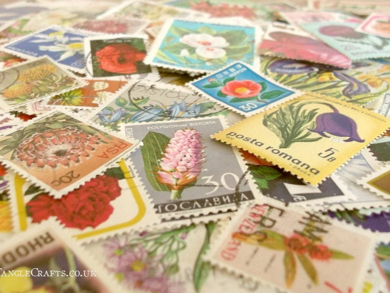 Use these used vintage postage stamps in so many craft and decor projects.