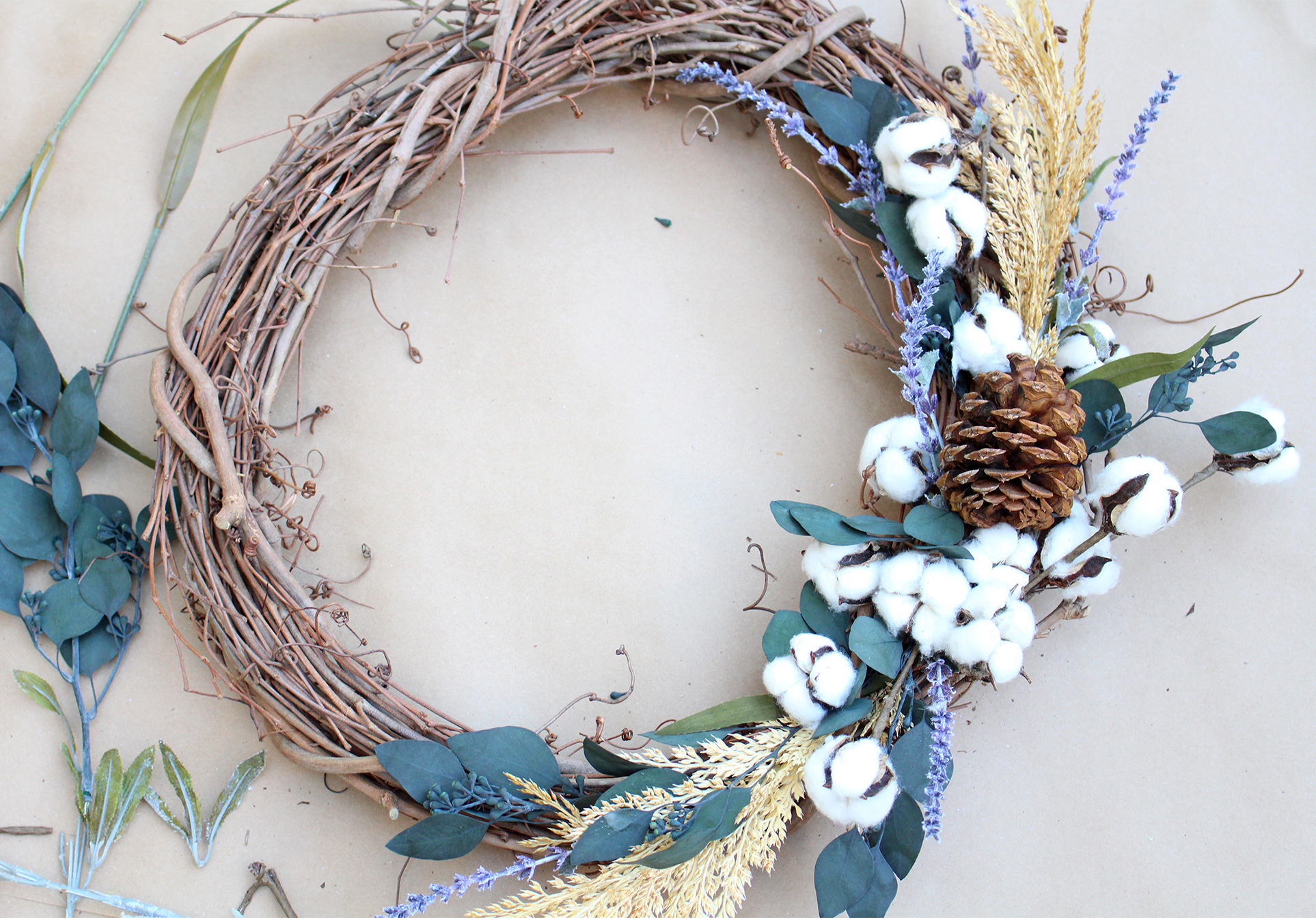 Use raw cotton, lavender, eucalyptus and pinecones to make a pretty DIY fall wreath